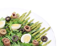 Salad with anchovies and asparagus. Stock Photos