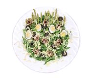 Salad with anchovies and asparagus. Royalty Free Stock Image