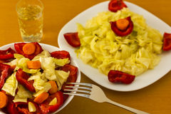 Salad with aperitif. Salad in cup and plate with aperitif served on table Royalty Free Stock Images