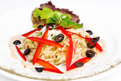 Salad with apples, cucumber, red pepper and olives. On the plate Stock Image