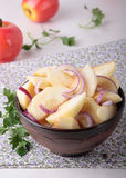 Salad of apples and red onions in bowl Royalty Free Stock Photo