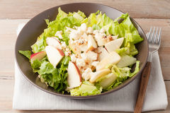 Salad with apples and walnuts on rustic wooden background Stock Photos