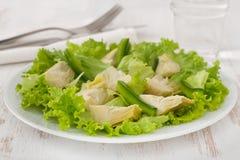 Salad artichoke with lettuce Stock Image