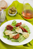 Salad with artichoke in the plate Royalty Free Stock Images
