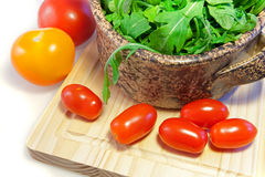Salad of arugula. And tomato-sherry with garlic royalty free stock photo