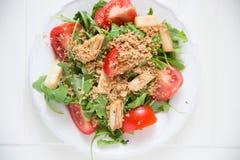 Salad with arugula, asparagus and tomato. Fresh Salad with arugula, asparagus and tomato Stock Image
