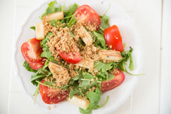 Salad with arugula, asparagus and tomato Royalty Free Stock Images