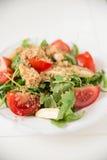 Salad with arugula, asparagus and tomato. Fresh Salad with arugula, asparagus and tomato Stock Photography