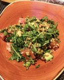 Healthy salad with Spelt and Arugula. Salad with Arugula, Avocado ,Tomato and Spelt in a restaurant royalty free stock photography