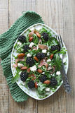 Salad with arugula,blackberry,feta cheese,almonds and prosciutto Stock Photography