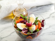 Salad with arugula carrot and egg Stock Photo
