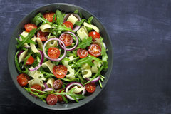 Salad with arugula and cheese Royalty Free Stock Images