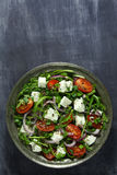 Salad with arugula and cheese. Salad with arugula, cheese, tomato and red onion royalty free stock photo