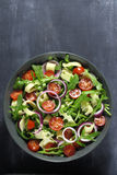 Salad with arugula, cheese and tomato. Royalty Free Stock Photos