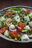 Salad with arugula, cheese and tomato. Stock Image