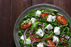 Salad with arugula, cheese and tomato. Royalty Free Stock Image