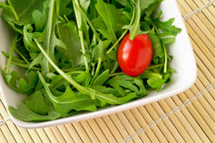Salad with arugula and cherry tomato Royalty Free Stock Photos