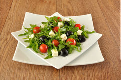 Salad of arugula with cherry tomatoes and grapes Stock Image