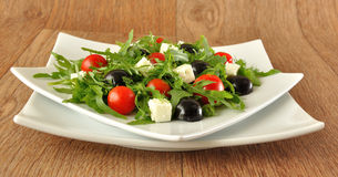 Salad of arugula with cherry tomatoes and grapes Stock Images