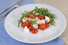 Salad arugula with cherry tomatoes and mozzarella Royalty Free Stock Images