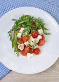 Salad arugula with cherry tomatoes and mozzarella Stock Photography