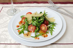 Salad of arugula and cherry tomatoes with parmesan sauce Royalty Free Stock Image