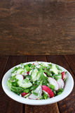 Salad with arugula, cucumber and cottage cheese Stock Photos