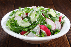 Salad with arugula, cucumber and cottage cheese Stock Image