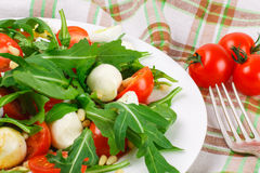 Salad with arugula on a fabric background Stock Photo