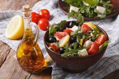 Salad with arugula, feta and tomatoes close-up, horizontal Stock Photos