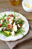 Salad with arugula, figs, pears and slices of cheese on a plate Royalty Free Stock Photos