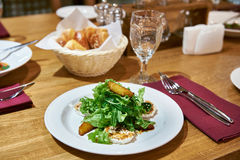 Salad with arugula with fried cheese and orange slices Royalty Free Stock Photos