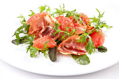 Salad with arugula, grapefruit and ham Royalty Free Stock Image
