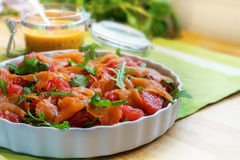 Salad with arugula, grapefruit and salmon, a fresh summer meal f Royalty Free Stock Photo