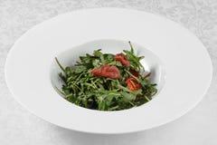 Salad of Arugula and ham Stock Image