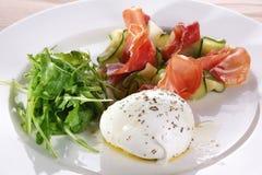 Salad with arugula, mozzarella, ham and zucchini. Stock Photography