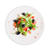 Salad with arugula and olives. Salad with arugula, olives, tomatoes and cheese Royalty Free Stock Photos