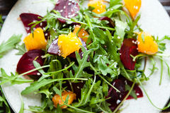 Salad with arugula and orange Stock Images