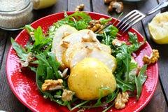 Salad of arugula with pear and lemon sauce Royalty Free Stock Photos