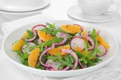 Salad with arugula, radish and tangerine Royalty Free Stock Photography