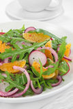 Salad with arugula, radish and tangerine Royalty Free Stock Photo