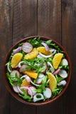 Salad with arugula, radish and tangerine Stock Photos