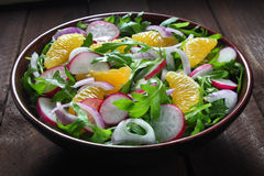 Salad with arugula, radish and tangerine Stock Image