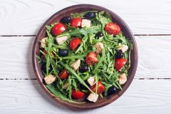 Salad with arugula. Tomatoes , olives and chicken stock images