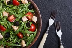 Salad with arugula. Tomatoes , olives and chicken stock photo