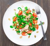 Salad with arugula, salmon and cherry tomato Royalty Free Stock Photography