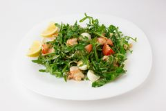Salad with arugula and shrimp. Fresh dish with arugula, cherry tomatoes, shrimp on a plate Stock Images