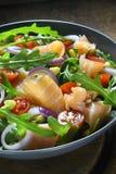Salad with arugula and smoked salmon Royalty Free Stock Photos