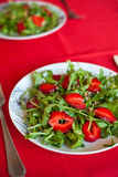 Salad With Arugula And Strawberries. Close-up salad with fresh strawberries, arugula and sunflower seeds royalty free stock photo