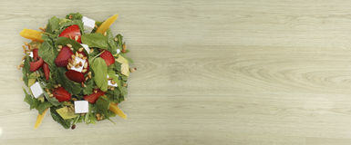 Salad with arugula,strawberries and cheese stock image